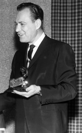 Sid Ordower accepts the Emmy Award in 1966 photo